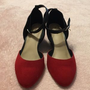 Red suede pointy wedge.